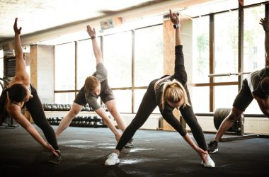 Group of multi ethnic young people working out together at the gym